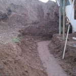 Compacted and Preparing Soil Under Wall