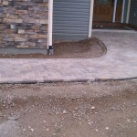 Herringbone Pattern Paver Pathway Connects Drive and Door