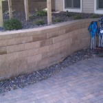 Large Block Retaining Wall Holds Elevation